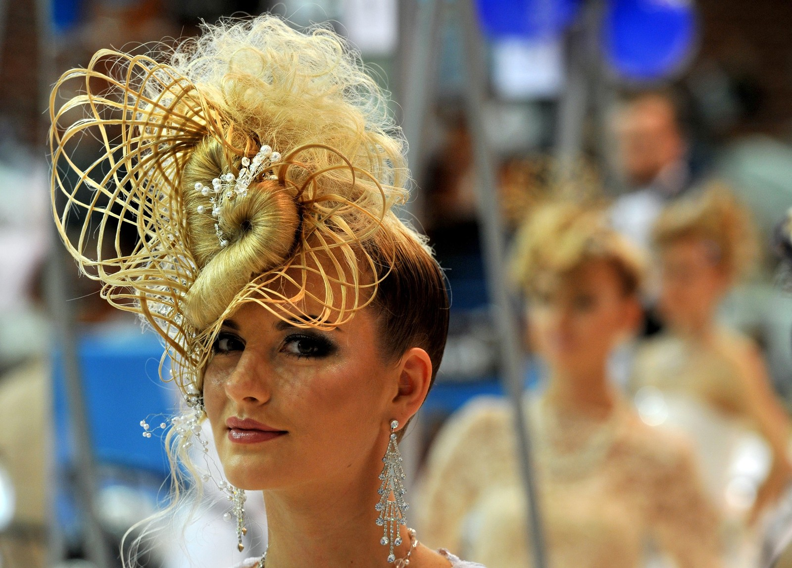 "A model displays a creation by fashion design students during the international beauty festival of young designers ""Nevskie berega"" (Neva river banks) in Saint Petersburg on September 27, 2013. AFP PHOTO / OLGA MALTSEVA (Photo credit should read OLGA MALTSEVA/AFP/Getty Images)"